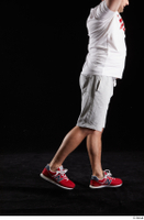 Louis  2 dressed flexing grey shorts leg red sneakers side view sports 0009.jpg