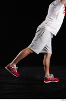 Louis  2 dressed flexing grey shorts leg red sneakers side view sports 0010.jpg
