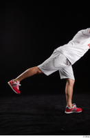 Louis  2 dressed flexing grey shorts leg red sneakers side view sports 0011.jpg