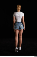 Vinna Reed  1 back view blue jeans shorts dressed sports walking white sneakers white t shirt whole body 0002.jpg