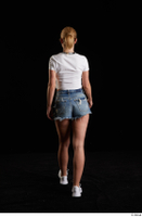 Vinna Reed  1 back view blue jeans shorts dressed sports walking white sneakers white t shirt whole body 0004.jpg