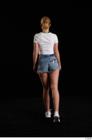 Vinna Reed  1 back view blue jeans shorts dressed sports walking white sneakers white t shirt whole body 0005.jpg