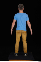 Lutro black sneakers blue t shirt casual dressed standing whole body yellow jeans 0005.jpg