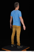 Lutro black sneakers blue t shirt casual dressed standing whole body yellow jeans 0006.jpg
