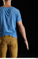 Lutro  1 arm back view blue t shirt casual dressed flexing 0001.jpg