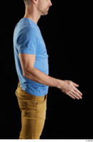 Lutro  1 arm blue t shirt casual dressed flexing side view 0002.jpg