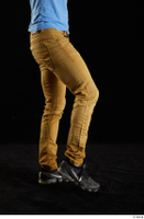 Lutro  1 black sneakers casual dressed flexing leg sitting yellow jeans 0002.jpg