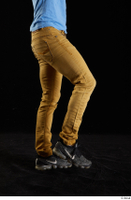 Lutro  1 black sneakers casual dressed flexing leg sitting yellow jeans 0003.jpg