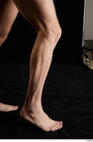Lutro  1 calf flexing nude side view 0007.jpg
