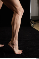 Lutro  1 calf flexing nude side view 0008.jpg