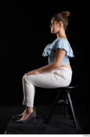 Serina Gomez  1 blue carmen shirt casual dressed grey high heels sitting white trousers whole body 0001.jpg