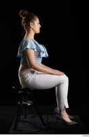 Serina Gomez  1 blue carmen shirt casual dressed grey high heels sitting white trousers whole body 0005.jpg