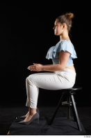 Serina Gomez  1 blue carmen shirt casual dressed grey high heels sitting white trousers whole body 0009.jpg