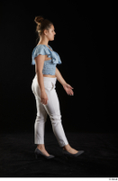 Serina Gomez  1 blue carmen shirt casual dressed grey high heels side view walking white trousers whole body 0001.jpg