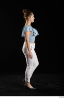Serina Gomez  1 blue carmen shirt casual dressed grey high heels side view walking white trousers whole body 0003.jpg