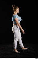 Serina Gomez  1 blue carmen shirt casual dressed grey high heels side view walking white trousers whole body 0004.jpg