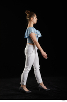 Serina Gomez  1 blue carmen shirt casual dressed grey high heels side view walking white trousers whole body 0005.jpg