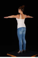 Serina Gomez blue jeans casual dressed grey high heels standing t poses white top whole body 0004.jpg