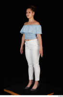 Serina Gomez blue carmen shirt casual grey high heels standing white trousers whole body 0002.jpg