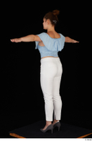 Serina Gomez blue carmen shirt casual grey high heels standing t poses white trousers whole body 0004.jpg