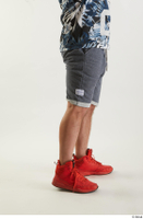 Neeo  1 blue shorts caf dressed flexing orange sneakers side view sports 0001.jpg