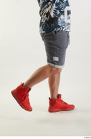 Neeo  1 blue shorts caf dressed flexing orange sneakers side view sports 0002.jpg