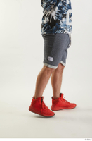 Neeo  1 blue shorts dressed flexing leg orange sneakers side view sports 0010.jpg