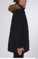 Arvid arm black coat black parka dressed sports upper body 0006.jpg