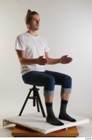 Arvid  1 blue jeans casual dressed sitting socks white t shirt whole body 0014.jpg