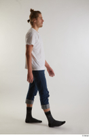 Arvid  1 blue jeans casual dressed side view socks walking white t shirt whole body 0001.jpg