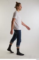 Arvid  1 blue jeans casual dressed side view socks walking white t shirt whole body 0002.jpg