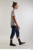 Arvid  1 blue jeans casual dressed side view socks walking white t shirt whole body 0004.jpg