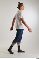 Arvid  1 blue jeans casual dressed side view socks walking white t shirt whole body 0005.jpg
