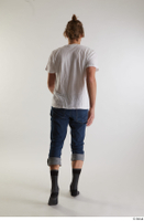 Arvid  1 back view blue jeans casual dressed socks walking white t shirt whole body 0002.jpg