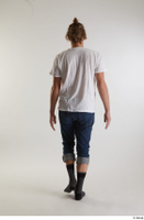 Arvid  1 back view blue jeans casual dressed socks walking white t shirt whole body 0003.jpg