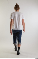 Arvid  1 back view blue jeans casual dressed socks walking white t shirt whole body 0004.jpg