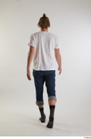 Arvid  1 back view blue jeans casual dressed socks walking white t shirt whole body 0005.jpg