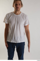 Arvid  1 arm casual dressed flexing front view white t shirt 0001.jpg