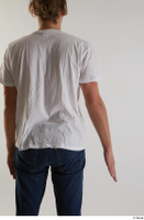 Arvid  1 arm back view casual dressed flexing white t shirt 0001.jpg