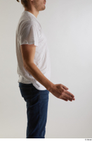 Arvid  1 arm casual dressed flexing side view white t shirt 0002.jpg