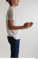 Arvid  1 arm casual dressed flexing side view white t shirt 0003.jpg