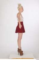 Lilly Bella brown ankle heeled boots casual dressed red short skirt standing white tank top whole body 0015.jpg