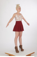 Lilly Bella brown ankle heeled boots casual dressed red short skirt standing white tank top whole body 0016.jpg