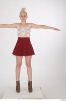 Lilly Bella brown ankle heeled boots casual dressed red short skirt standing t poses white tank top whole body 0001.jpg