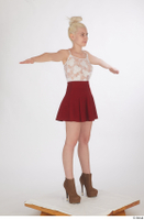 Lilly Bella brown ankle heeled boots casual dressed red short skirt standing t poses white tank top whole body 0008.jpg