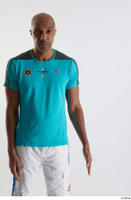 Tiago  1 arm blue t shirt dressed flexing front view sports 0001.jpg