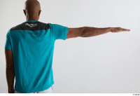 Tiago  1 arm back view blue t shirt dressed flexing sports 0003.jpg