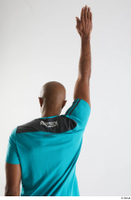 Tiago  1 arm back view blue t shirt dressed flexing sports 0005.jpg