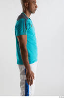 Tiago  1 arm blue t shirt dressed flexing side view sports 0001.jpg