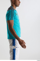 Tiago  1 arm blue t shirt dressed flexing side view sports 0002.jpg